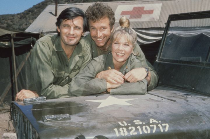 Alda is seen with fellow actors Wayne Rogers, as Captain Trapper John McIntyre, and Loretta Swit, as Major Margaret Houlihan,
