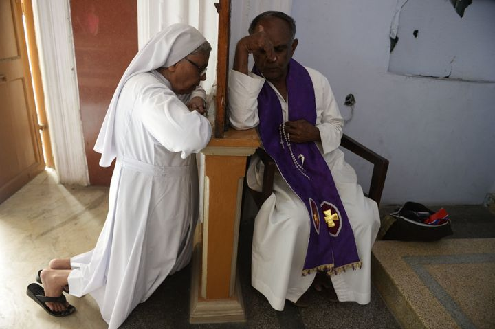 An Indian Catholic priest hears the confession of a nun at Saint Mary's Basilica in Secunderabad, the twin city of Hyderabad