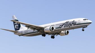 Los Angeles, USA - June 6, 2014: An airplane of Alaska Airlines landing at Los Angeles International Airport.