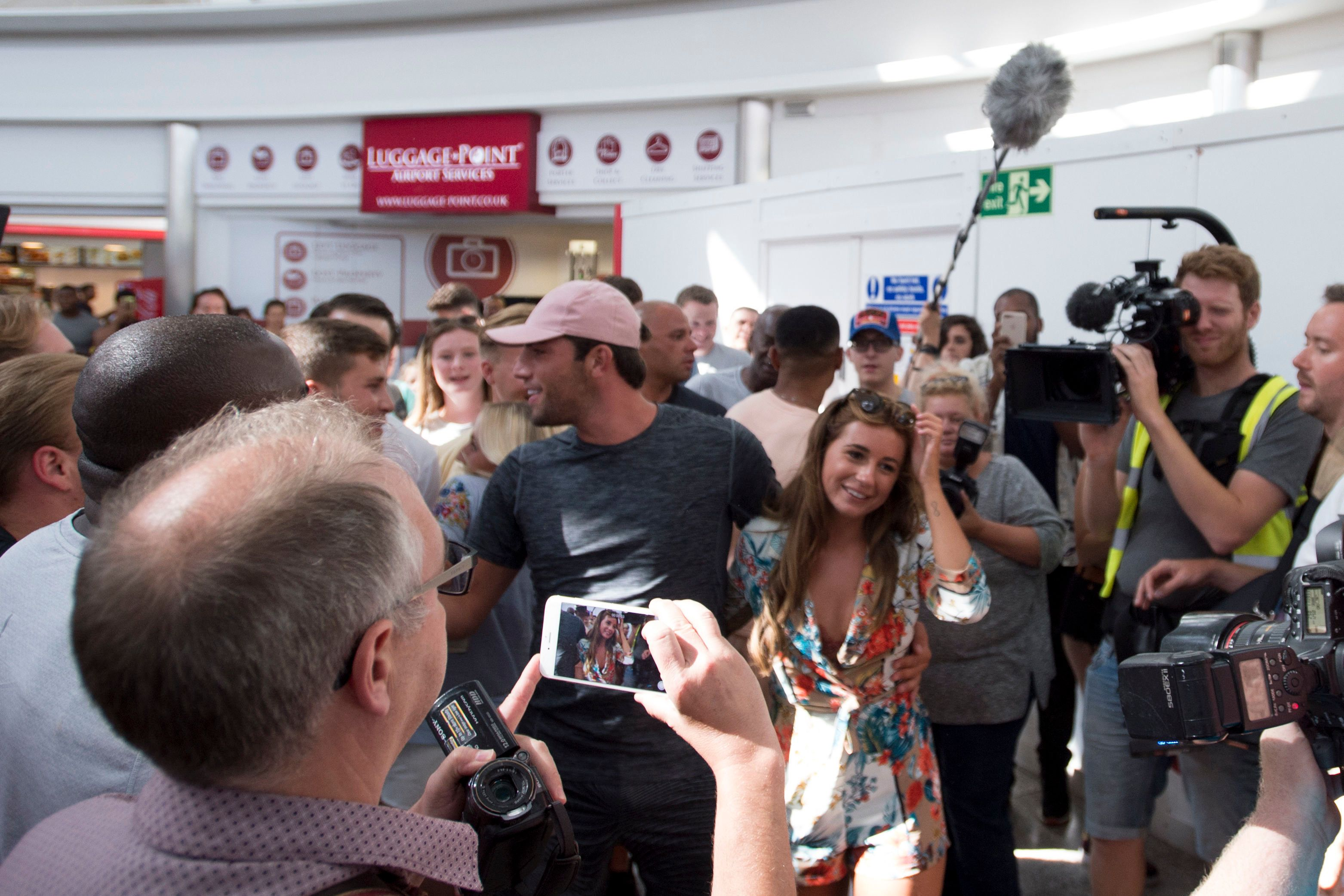 Jack and Dani were greeted by a mob of fans as they landed in the