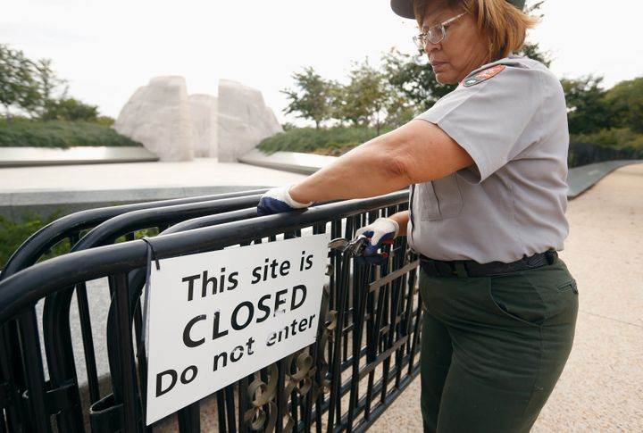 A National Park Service worker removesbarriers around the Martin Luther King Jr. Memorial inWashington after it w