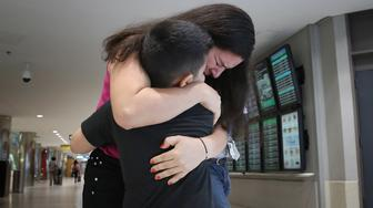 LINTHICUM, MD - JULY 23:  Seven-year-old Andy is reunited with his mother, Arely, at Baltimore-Washington International Airport July 23, 2018 in Linthicum, Maryland. Originally from El Salvador, the mother and son were separated upon entering the United States on June 13 with Arely being detained at the Port Isabel Detention Center in south Texas, and Andy being detained in New York. A court-ordered July 26th deadline is approaching for the U.S. government to reunite as many as 2,551 migrant children ages 5 to 17 that had been separated from their families after they crossed into the U.S. along the border. (Photo by Win McNamee/Getty Images)