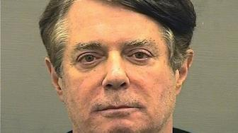 Former Trump campaign manager Paul Manafort is shown in this booking photo in Alexanderia, Virginia, U.S., July 12, 2018.   Alexandria Sheriff's Office/Handout via REUTERS   ATTENTION EDITORS - THIS IMAGE WAS PROVIDED BY A THIRD PARTY. THIS PICTURE WAS PROCESSED BY REUTERS TO ENHANCE QUALITY. AN UNPROCESSED VERSION HAS BEEN PROVIDED SEPARATELY