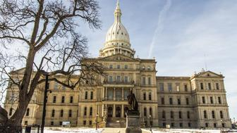 Lansing, Michigan, USA - January 20, 2018: Campus and front entrance to the Michigan state capitol building in downtown Lansing.