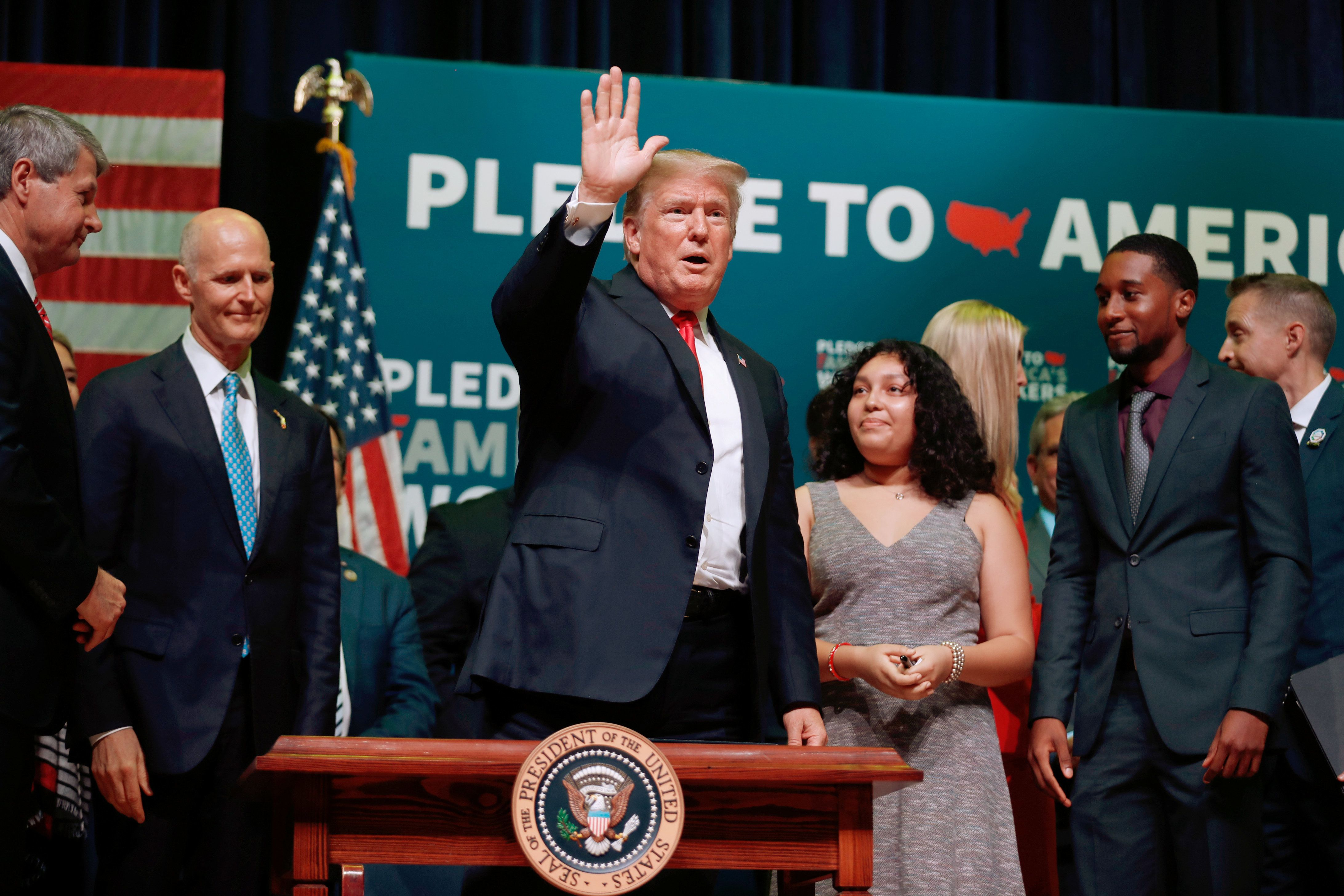 """U.S. President Donald Trump acknowledges supporters after after the ceremonial signing of H.R. 2353, the """"Strengthening Career and Technical Education for the 21st Century Act"""" at Tampa Bay Technical High School in Tampa, Florida, U.S., July 31, 2018.   REUTERS/Carlos Barria"""