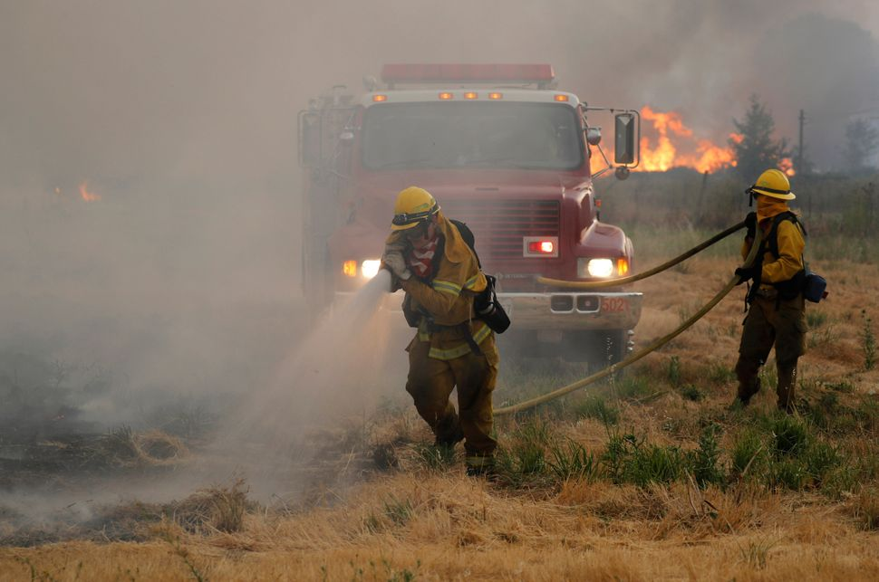 Firefighters attacked hotspots to slow the spread of the River Fire.