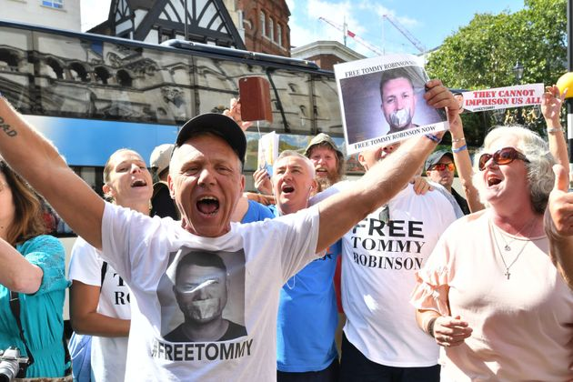 Supporters of Tommy Robinson celebrate outside the Royal Court of