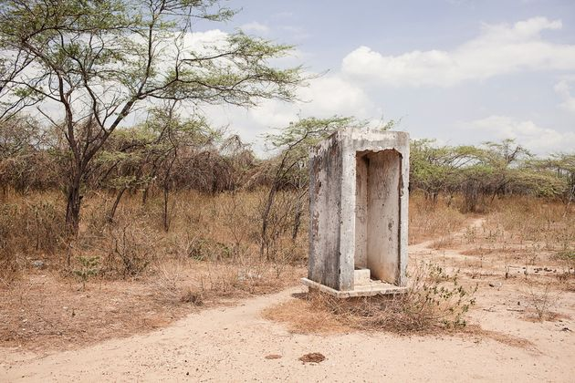 An abandoned toilet at Totcomana school,