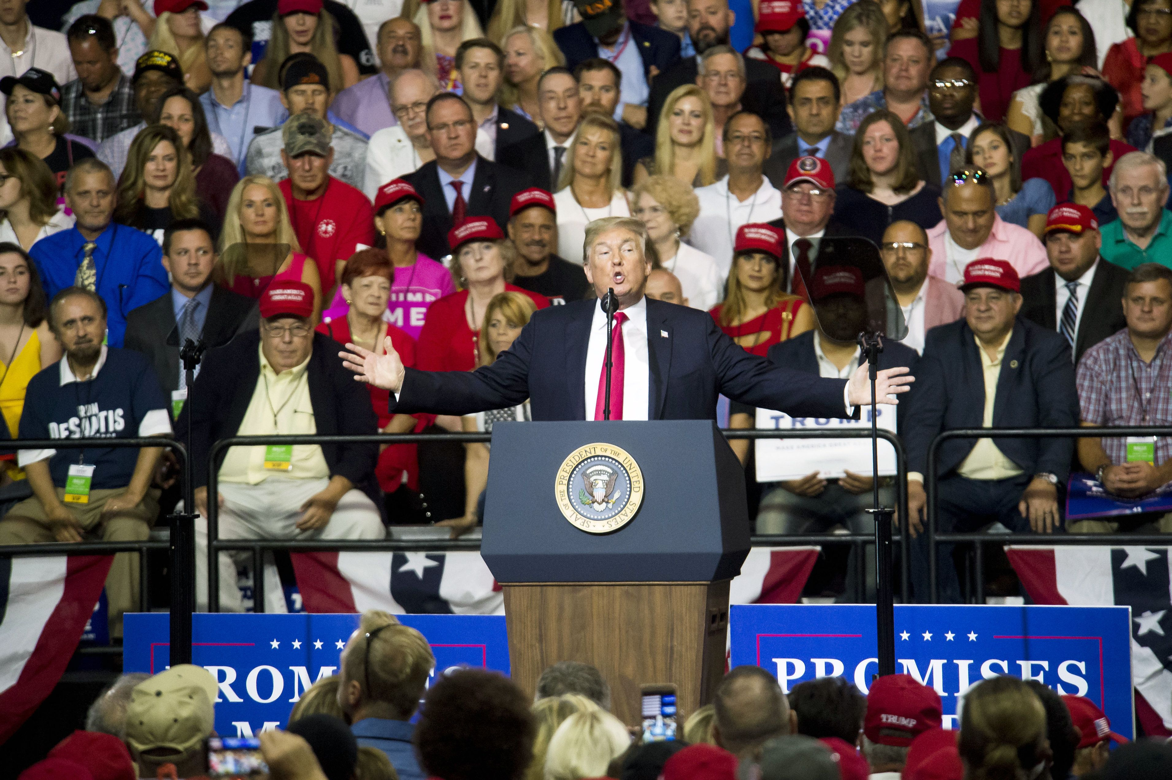 U.S. President Donald Trump gestures as he addresses the crowd during a rally in Tampa, Florida, U.S., on Tuesday, July 31, 2018. Iranian Foreign Minister Javad Zarif pushed back on Trump's suggestion that he'd be willing to meet President Hassan Rouhani with 'no preconditions,' saying the two countries spent plenty of time in negotiations already. Photographer: Zack Wittman/Bloomberg via Getty Images