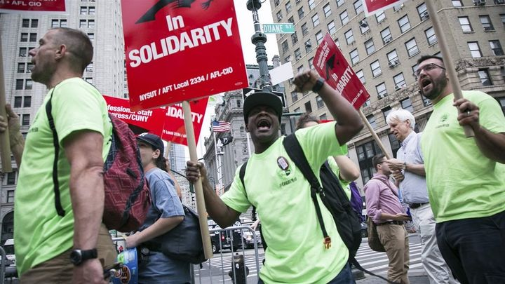 Union activists and supporters rally in Lower Manhattan against the U.S. Supreme Court's ruling in the Janus case. Over 20 st