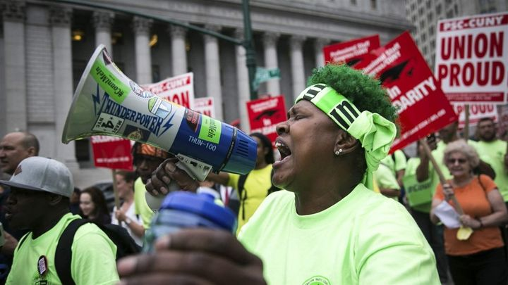 Union activists and supporters rally in Lower Manhattan against the U.S. Supreme Court's ruling in the Janus case. New York s