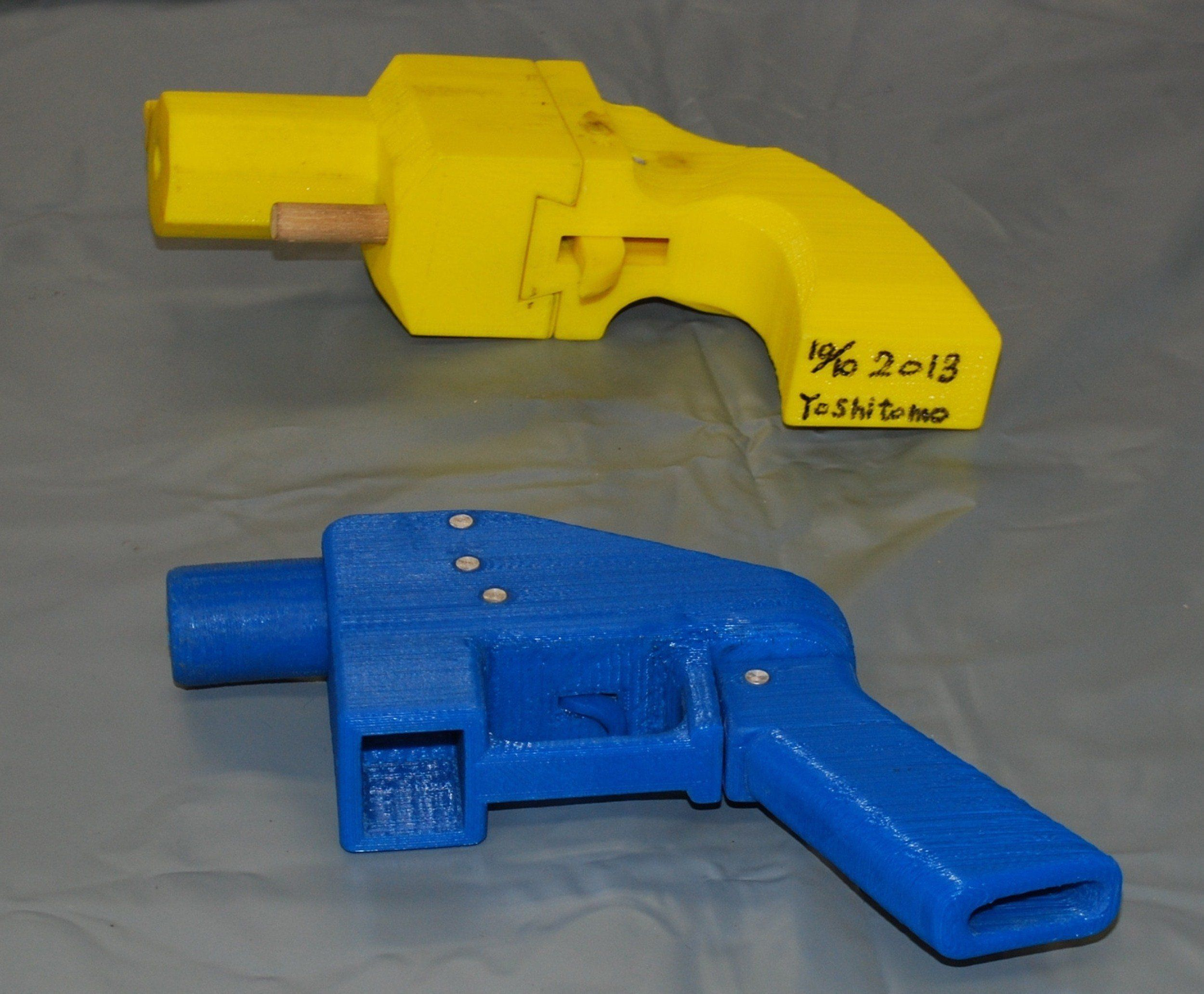 Seized plastic made guns produced by a 3-D printer are displayed at a police station in Yokohama on May 8, 2014.  A Japanese man suspected of possessing guns made with a 3-D printer has been arrested in what was said to be the country's first such detention. Officers who raided the home of Yoshitomo Imura, a 27-year-old college employee, confiscated five weapons, two of which had the potential to fire lethal bullets.   AFP PHOTO / JIJI PRESS    JAPAN OUT        (Photo credit should read JIJI PRESS/AFP/Getty Images)