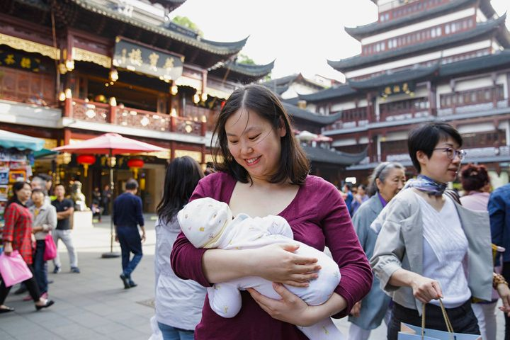 Tanxian, a Chinese mother, nurses her baby in Shanghai.