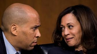 UNITED STATES - JANUARY 16: Sen. Cory Booker, D-N.J., and Sen. Kamala Harris, D-Calif., talk during the Senate Judiciary Committee hearing on 'Oversight of the United States Department of Homeland Security' on Tuesday, Jan. 16, 2018. (Photo By Bill Clark/CQ Roll Call)