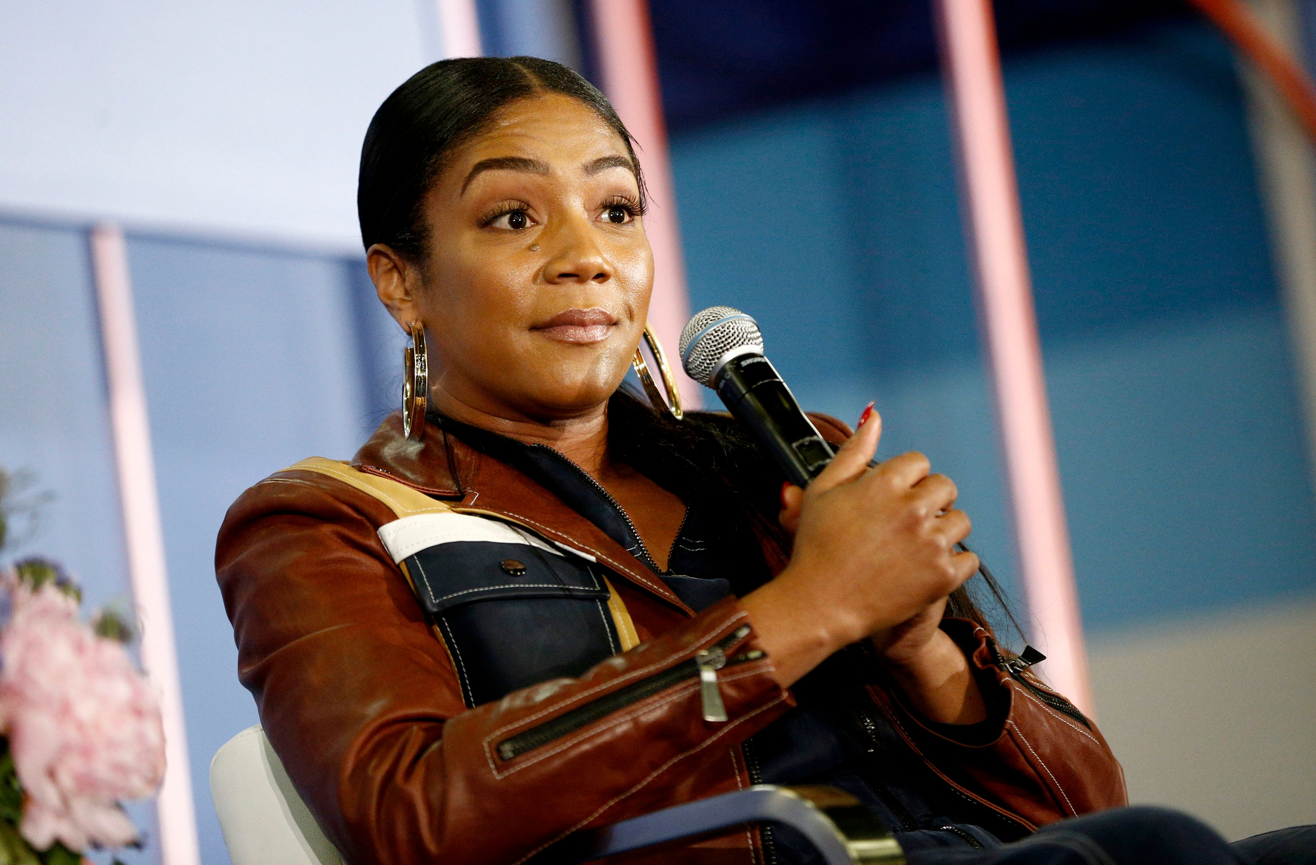 """Haddish speaks on stage during """"The Last Laugh"""" panel on day two of Popsugar Play/Ground on June 10, 2018."""