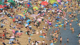 DALIAN, CHINA - JULY 31:  People enjoy themselves at a beach to beat the heat as the temperature reaches 31 degrees on July 31, 2016 in Dalian, China.  (Photo by VCG/VCG via Getty Images)