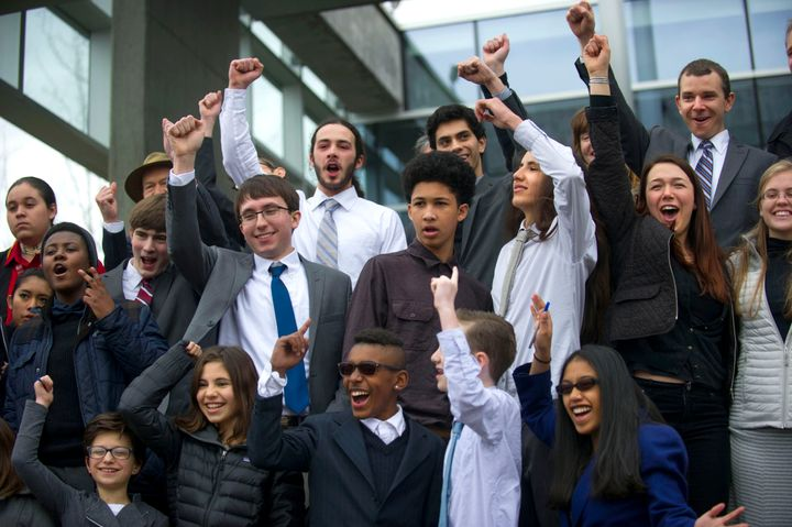 A group of youth plaintiffs cheer after a press briefing outside the federal courthouse in Eugene after a hearing in district