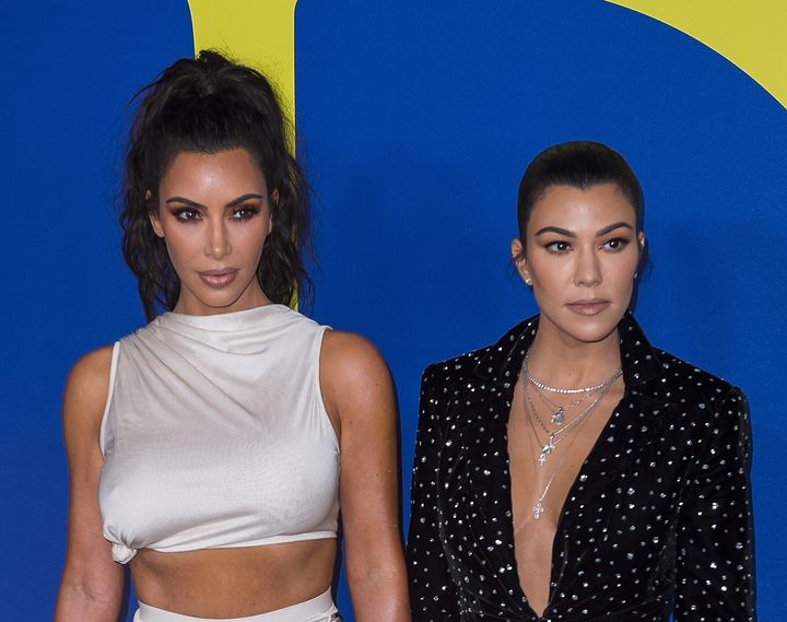 Kim Kardashian (left) and sister Kourtney Kardashian attend the annual Council of Fashion Designers of America awards show&nb