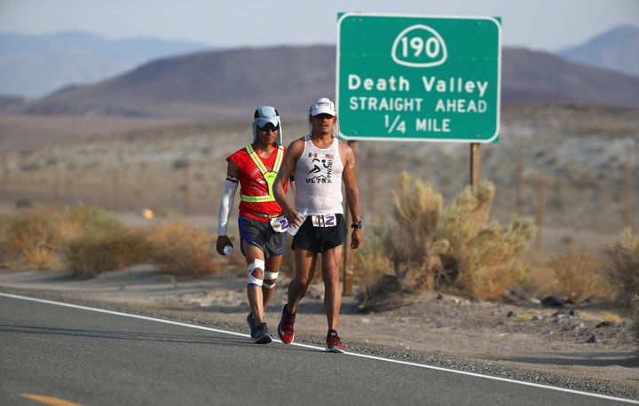 People walk through Death Valley in July 2017, the month previously recorded as the planet's hottest.