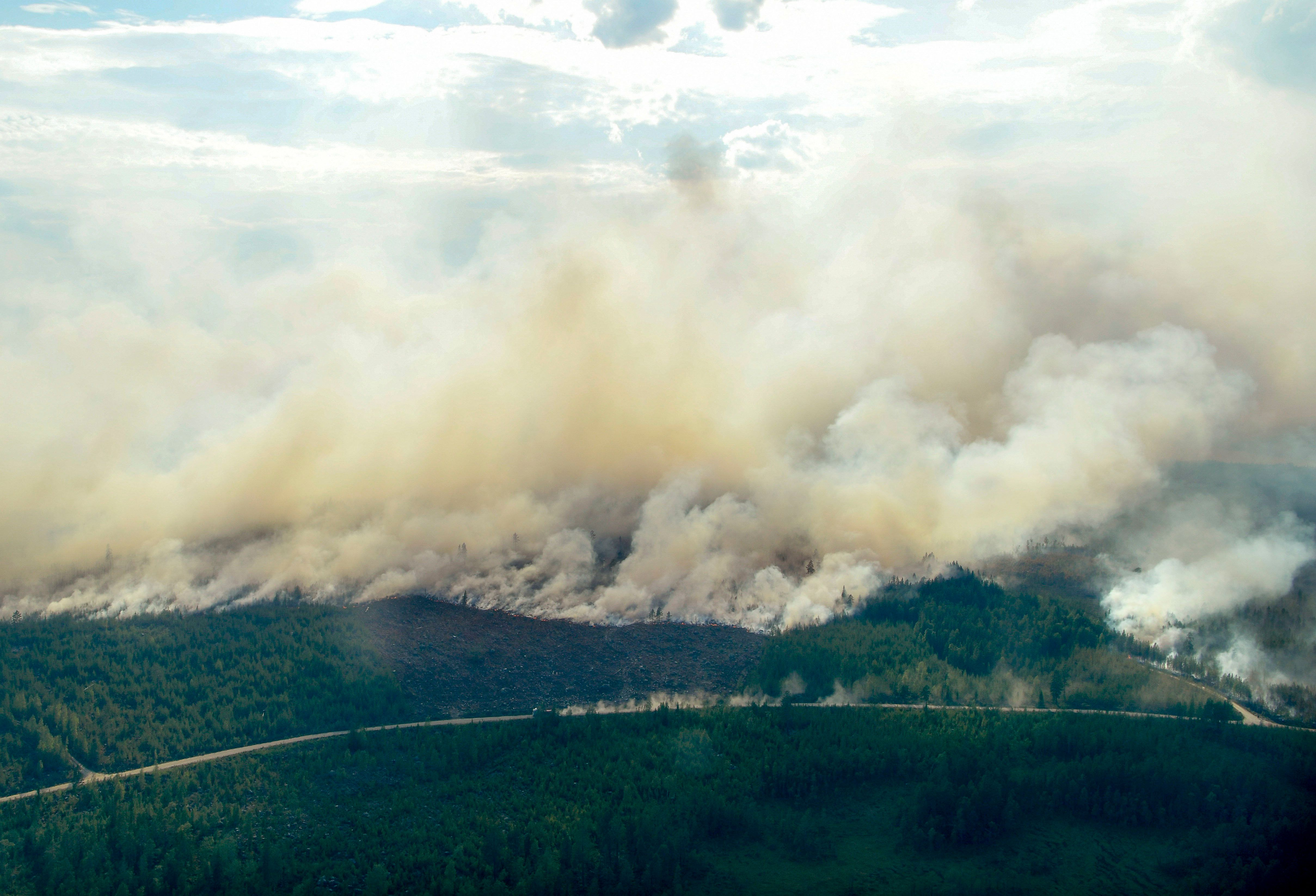 Aerial image shows the Forest fires burning near Ljusdal, Sweden on July 18, 2018. (Photo by Maja SUSLIN / various sources / AFP) / Sweden OUT        (Photo credit should read MAJA SUSLIN/AFP/Getty Images)