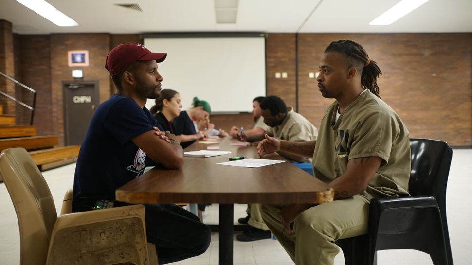Lee Mitchell, Jr., a detainee at the Cook County jail in Chicago, registers to vote in July.