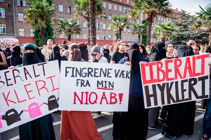 Women wearing niqab to veil their faces take part in a demonstration on Aug. 1, 2018, the first day of the implementation of