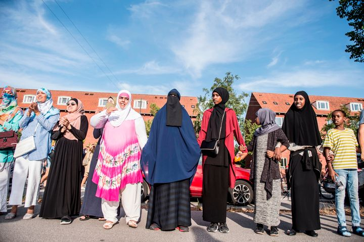 Veiled women take part in a demonstration against the veil ban on Aug. 1, 2018, the first day of the implementation of the Da