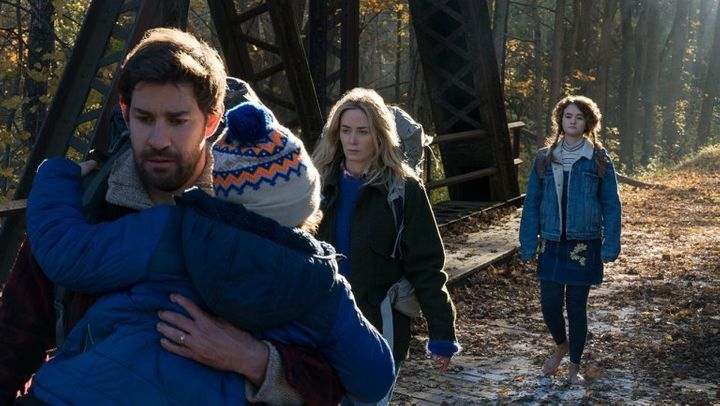"Krasinski and Blunt in ""A Quiet Place"" along with Millicent Simmonds and Cade Woodward, who played their children"