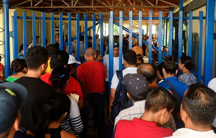 Nicaraguans line up at a migration office in Managua on June 13 to obtain passports to be able to go to other Central Am