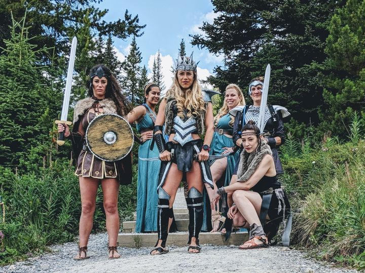 """Alex Pinkerton, center, said the costumes were an ode to all the women out there who are """"battling to maintain their rightful place in their environment."""""""