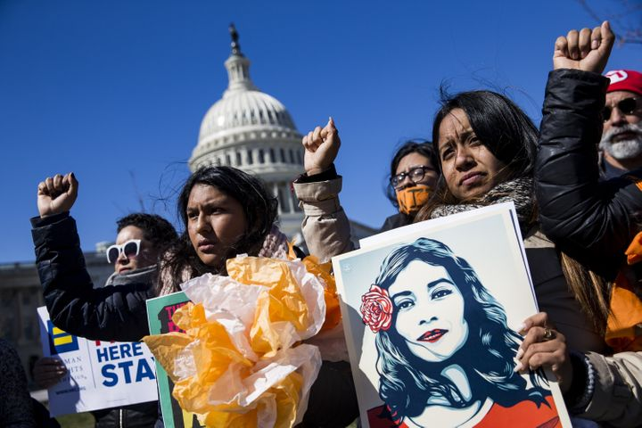 Demonstrators outside the Capitol protest President Donald Trump's efforts to end the Deferred Action for Childhood Arr