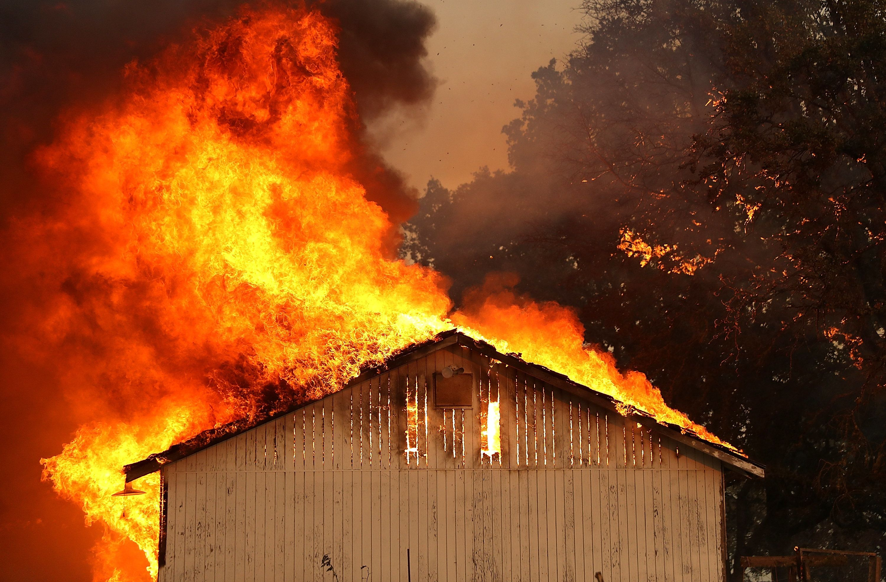 LAKEPORT, CA - JULY 31:  A home burns as the River Fire moves through the area on July 31, 2018 in Lakeport, California. The River Fire has burned over 27,000 acres, destroyed seven homes and stands at only eight percent contained.  (Photo by Justin Sullivan/Getty Images)