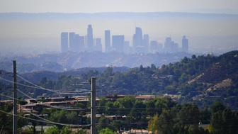 A layer of pollution can be seen hovering over Los Angeles, California on October 17, 2017, where even though air quality has improved in recent decades, smog levels remain among the nations's worst, with wildfires in the region also contributing to poor air quality.  / AFP PHOTO / FREDERIC J. BROWN        (Photo credit should read FREDERIC J. BROWN/AFP/Getty Images)