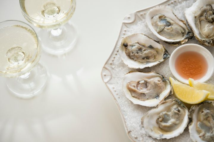 Mignonette (seen in the center of the oysters) is a classic sauce made of red wine vinegar and minced shallot.