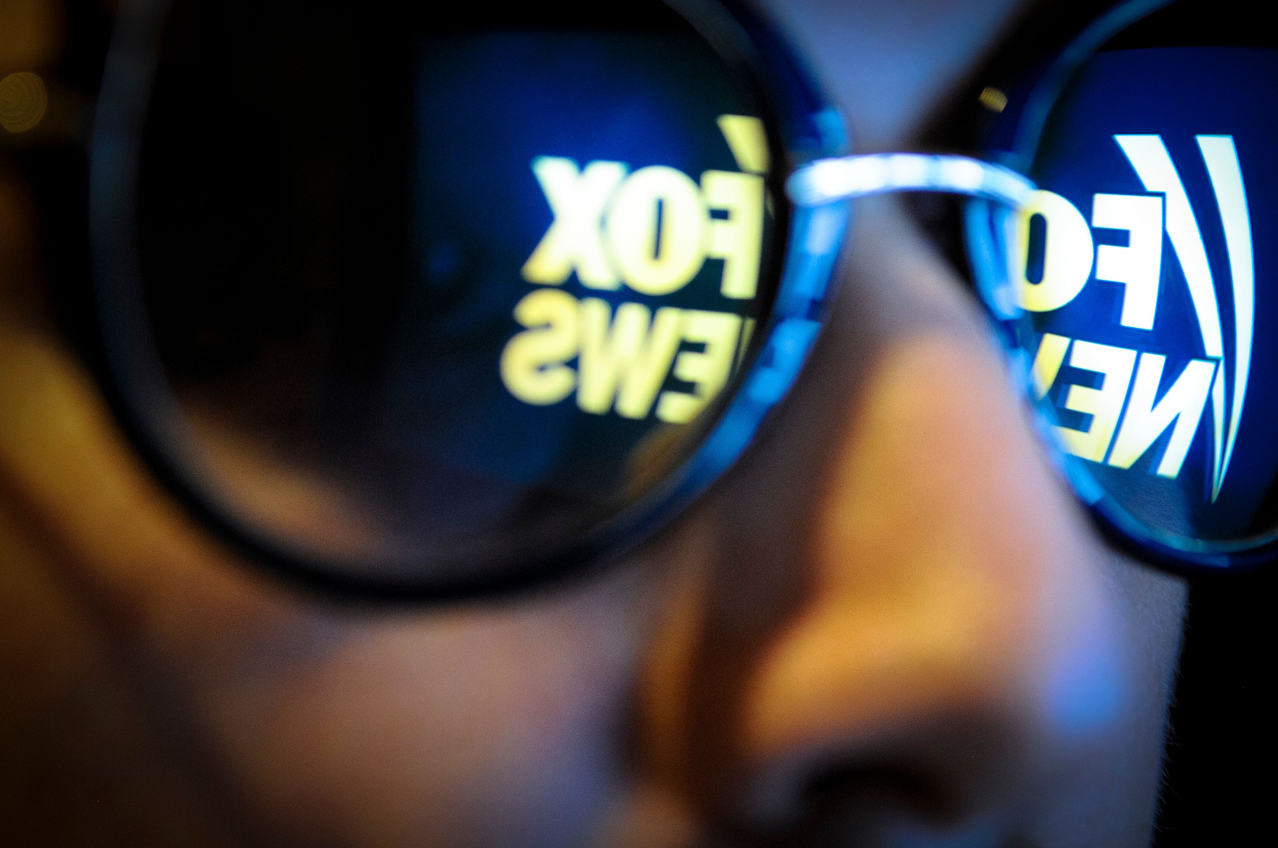 The Fox News logo is seen reflected in a pair of sunglasses on November 3, 2017. (Photo by Jaap Arriens/NurPhoto via Getty Images)