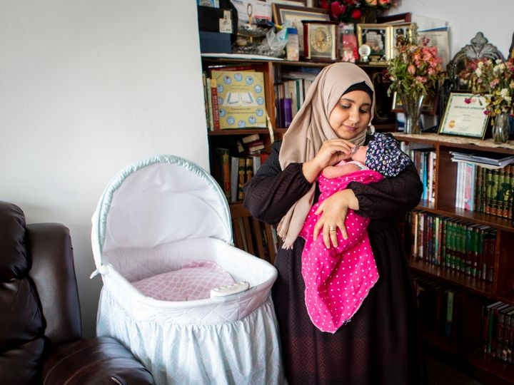 Sondos al-Silwi and her 2-week-old daughter, Mayar. Because of the travel ban on immigration from several Musl