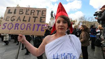 A woman dressed as Marianne, national symbol of the French Republic, takes part on the Place de la Republic in Paris on November 25, 2017 in a demonstration against violence against women. November 25 is the International Day for the Elimination of Violence Against Women. (Photo by Michel Stoupak/NurPhoto via Getty Images)