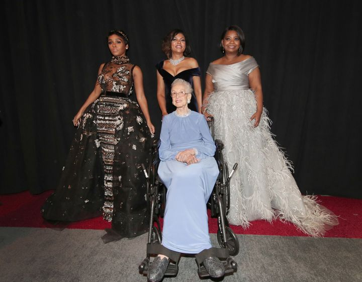 NASA mathematician Katherine Johnson and actors Taraji P. Henson, Octavia Spencer and Janelle Monae pose backstage during the