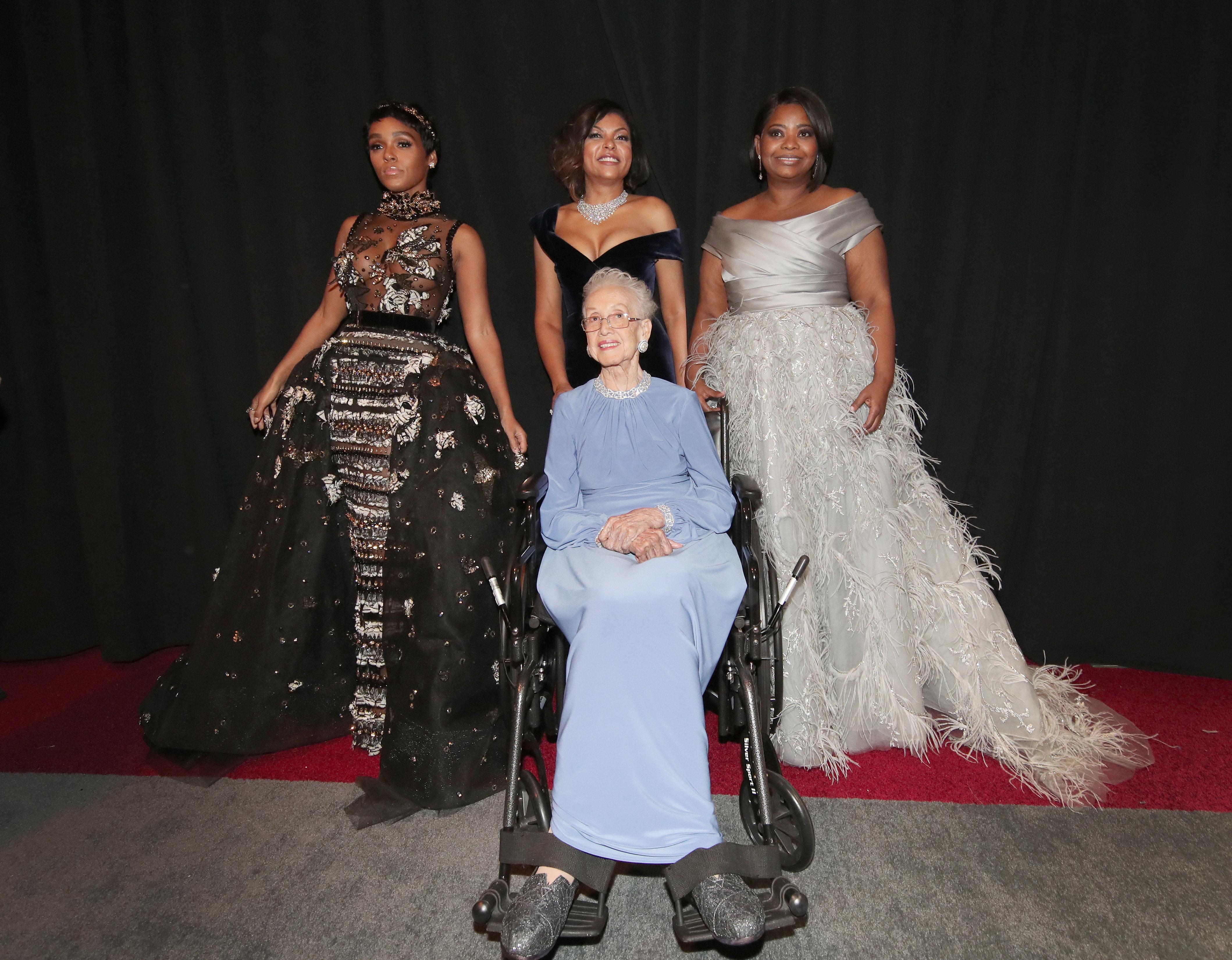 NASA mathematician Katherine Johnson and actors Taraji P. Henson, Octavia Spencer and Janelle Monae pose backstage during the