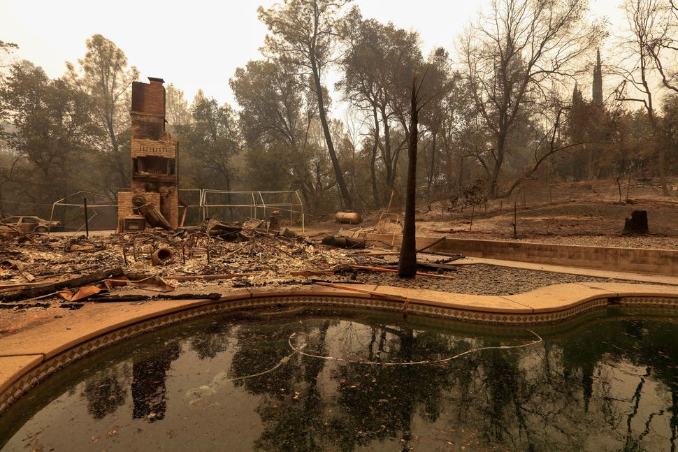 The debris of a burned home is seen July 28 after the Carr Fire west of Redding, California.