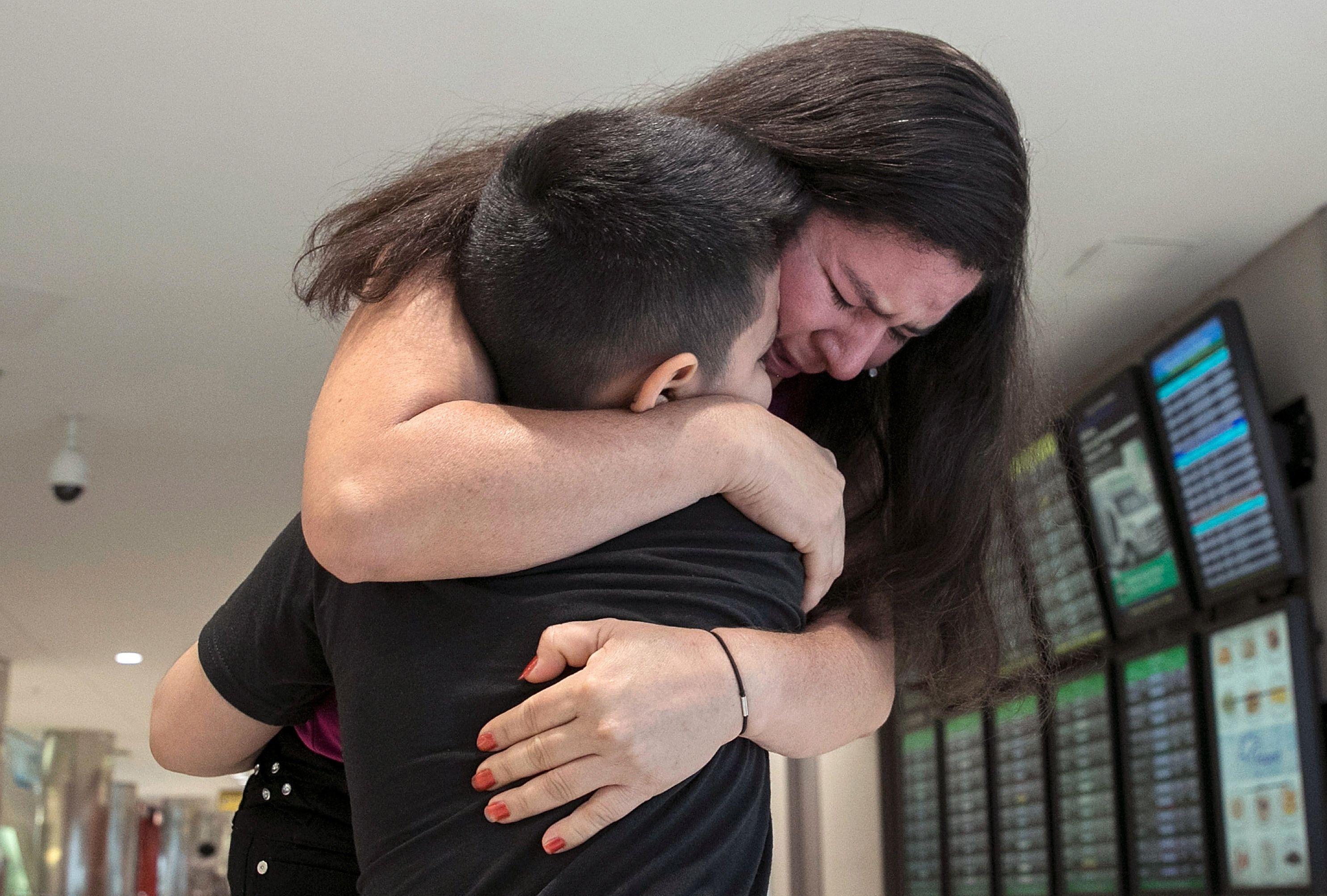 Seven-year-old Andy is reunited with his mother, Arely, at Baltimore-Washington International Airport July 23, 2018 in Linthi