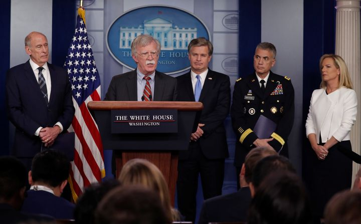 Director of National Intelligence Dan Coats, left, White House national security adviser John Bolton, FBI Director Chris