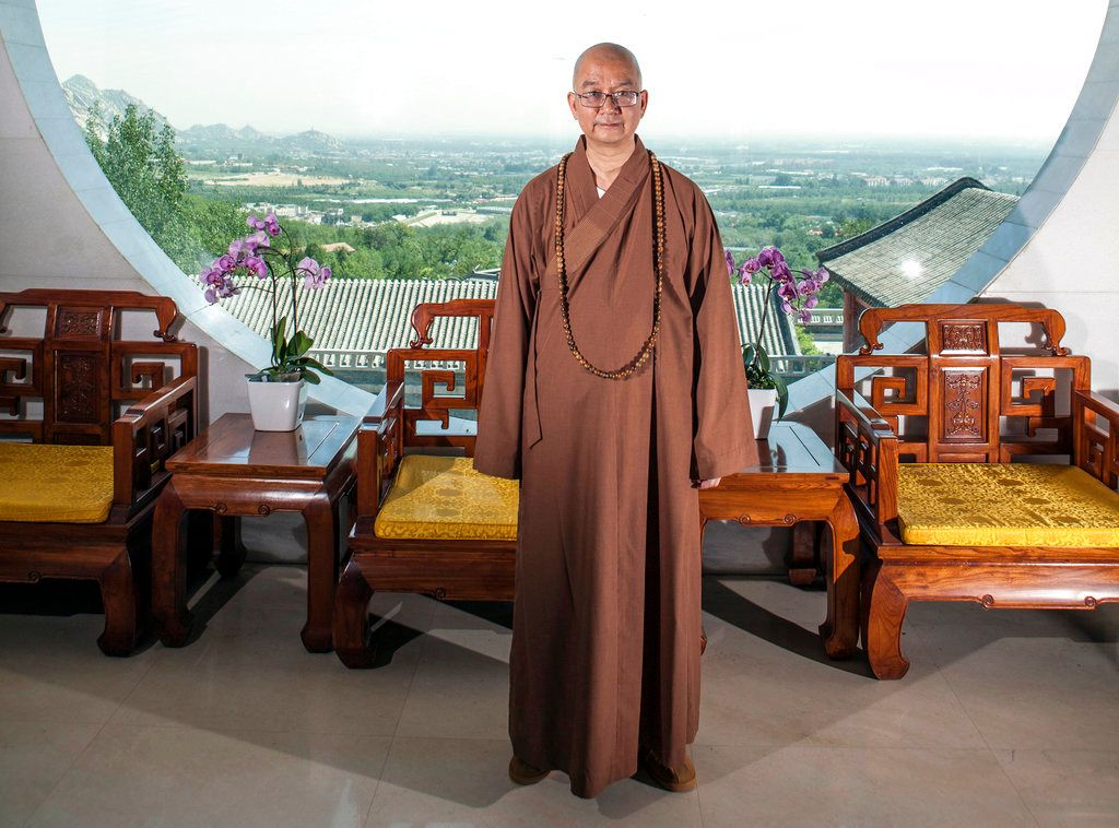 In this photo taken July 3, 2015, Abbot Xuecheng of the Beijing Longquan Temple poses for a photo in one of the temple buildi