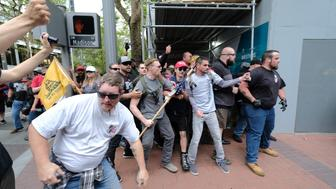 PORTLAND, USA - JUNE 03: Far-right Patriot Prayer supporters regroup after fighting antifascist counter-protesters during a freedom march in Terry Shrunk Plaza on June 03, 2018 in Portland, Oregon, United States.     (Photo by Alex Milan Tracy /Anadolu Agency/Getty Images)