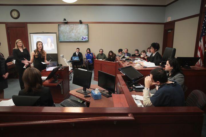 Kyle Stephens reads the first victim impact statement during Nassar's sentence hearing, Jan. 16, in Lansing, Michigan.