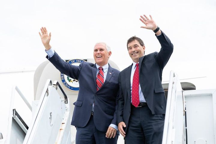 Vice President Mike Pence, left, and Republican candidate Troy Balderson wave to the crowd after a Pence rally for Balderson