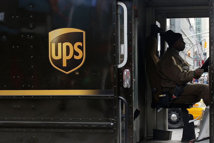 A UPS delivery truck makes its way through Times Square in New York on March 5, 2014.