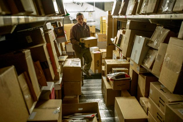 A UPS driver, loads his truck with packages at a UPS sorting facility in San Francisco,