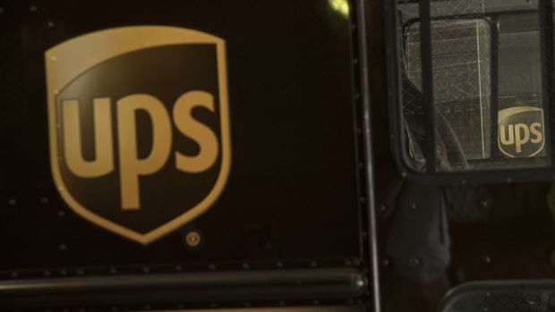 United Parcel Service Inc. (UPS) signage is seen on delivery trucks in New York, U.S, on Monday, July 24, 2017. United Parcel Service Inc. (UPS) is scheduled to release earnings figures on July 27. Photographer: Victor J. Blue/Bloomberg via Getty Images