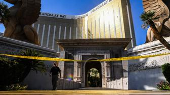 LAS VEGAS, NV - OCTOBER 4: An agent walks out of Mandalay Bay Hotel and Casino where Stephen Paddock, the gunman who killed 59 people and wounded more than 500 people Sunday's night during the Route 91 Harvest Country Music Festival is seen on Wednesday, October 4, 2017, in Las Vegas, NV. (Photo by Salwan Georges/The Washington Post via Getty Images)